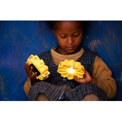Little Sun (Olafur Eliasson e Frederik Ottesen), Little girl playing with Little Sun - Original in Ethiopia; credit: Merklit Mersha